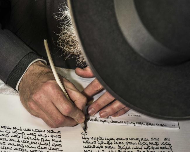 Image of Jewish man writing in Hebrew used for the focal image of The Jewish Evangelism Training Course by CMJ UK